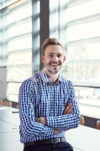 stock-photo-61671896-smiling-businessman-in-the-office